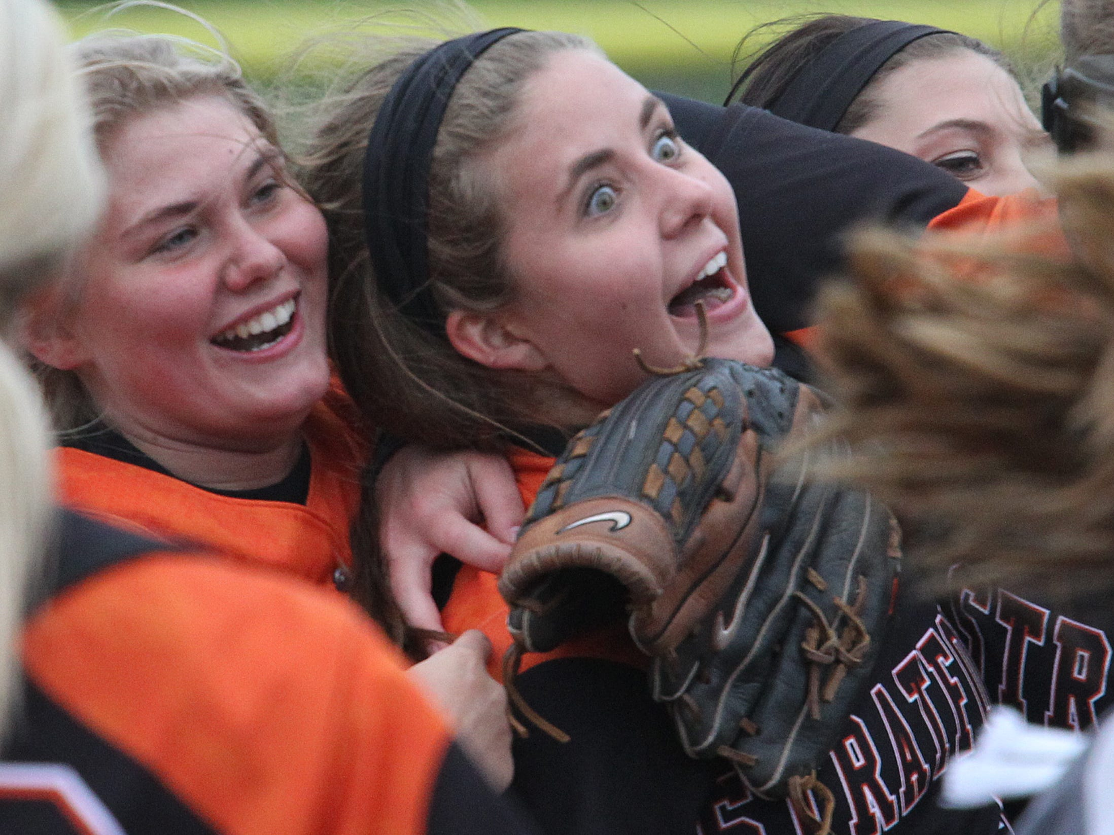 Stratford's Dallas Adams, left, and Casey Kolbeck celebrate Monday as the Tigers beat Marathon in Stratford to claim a tie for the Marawood Conference South title with Marathon.