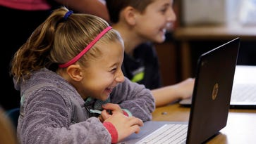In this photo taken Nov. 4, 2015, fifth grade students work on programming during their weekly computer science lesson at Marshall Elementary School in Marysville, Wash. The school, north of Seattle, joined a growing movement nationwide to expose more public school children to computer science, even as early as in kindergarten. Backed by technology leaders, nonprofits and companies, schools in New York, San Francisco and other cities have committed to offer computer science to students in all grade levels.