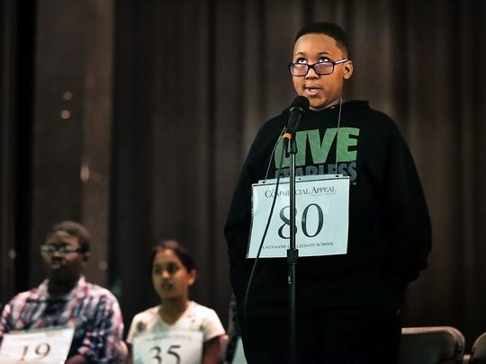 Third grader Myles Thomas tries to puzzle out a word during the Greater Memphis Spelling Bee at the Al Chymia Shrine Temple Saturday. In its 90th year, the spelling competition was a nail-biter this year: It lasted more than 20 rounds.