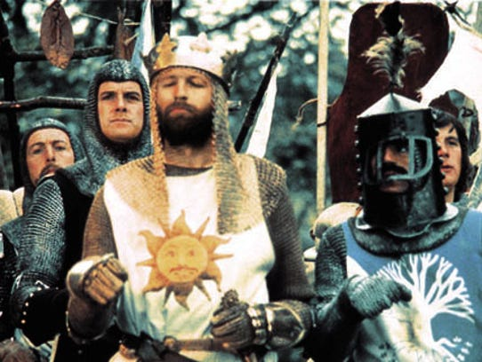 """Eric Idle, John Cleese and Graham Chapman, Terry Jones and Michael Palin, in a scene from the motion picture """"Monty Python and the Holy Grail."""""""