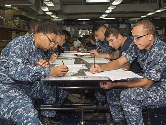Sailors aboard the amphibious assault ship USS Iwo