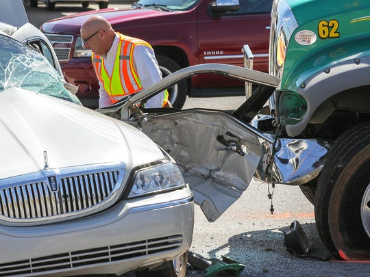 Don McCown, deputy coroner in Anderson County, looks over a fatal accident on S.C. 24 in Anderson County this year. Anthony H. May, 63, of Greenwood, drove through a red light before hitting the car with driver Estelle Wood, 79, in the middle of the intersection. May was wearing a seatbelt and was not injured, and Wood died in the accident, South Carolina Highway Patrol spokesman Trooper Joe Hovis said. May was cited for disregarding a traffic signal.