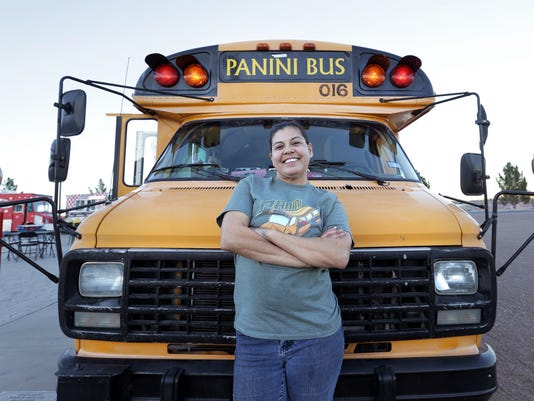 Panini Bus owner Cynthia Bertoldo stands in front of her food truck