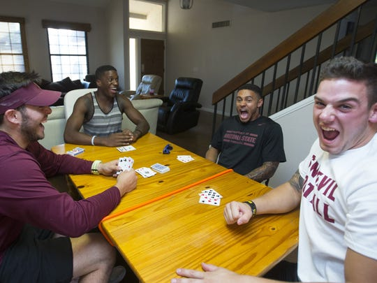 ASU football players roommates QB Mike Bercovici, left, Ellis Jefferson, a redshirt freshman receiver, WR DJ Foster, DB Jordan Simone, right,  play Gin in their Tempe home.