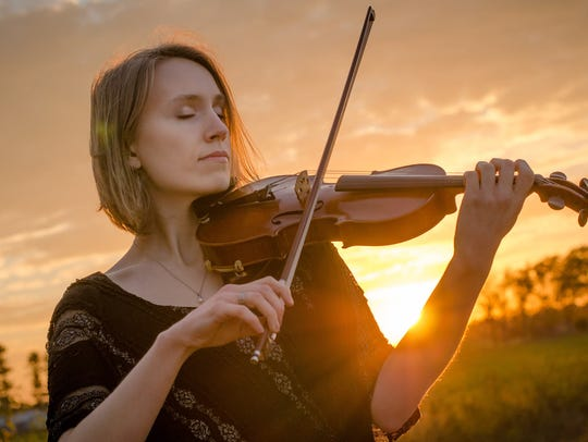Joanna Johnson is performing a solo classical violin