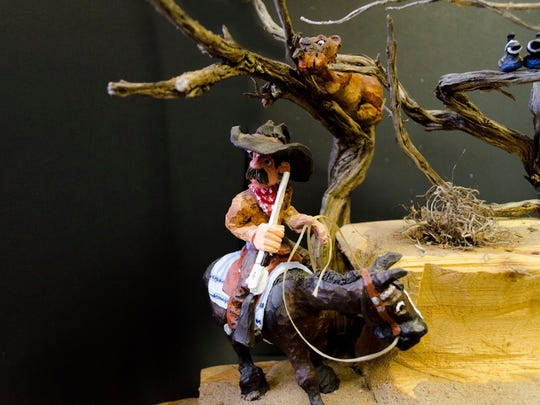 Wood carver Polly Kennedy of Wellsville, Utah, was born and raised on a ranch. She'll be bringing her carved pieces, like this one, to Cowboy True.