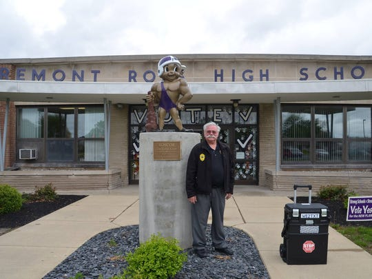 John Gordon, who speaks on distracted driving, stands in front of Fremont Ross High School after a recent talk.
