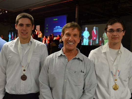 Todd Gruchacz, left, and Jeffrey Gruchacz, right, are pictured with Chris Scheuerman, auto technology instructor at Hunterdon County Polytech Career and Technical School, at a competition held earlier this year.