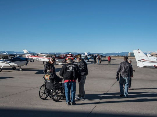 Veterans watch the crews take off from Centennial Airport as part of the Charity Airlift on Sunday, Dec. 10, 2017.
