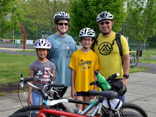 Sustainable Cherry Hill Earth Festival guests enjoy a family bike ride at the start of the festival. Cyclists can also bike to the festival and check their bikes at a free bike valet, supported by the Courier-Post.