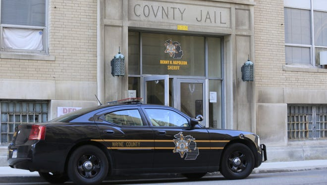 A Wayne County Sheriff's car is parked in front of the Wayne County Jail, Division II at 525 Clinton in Detroit.