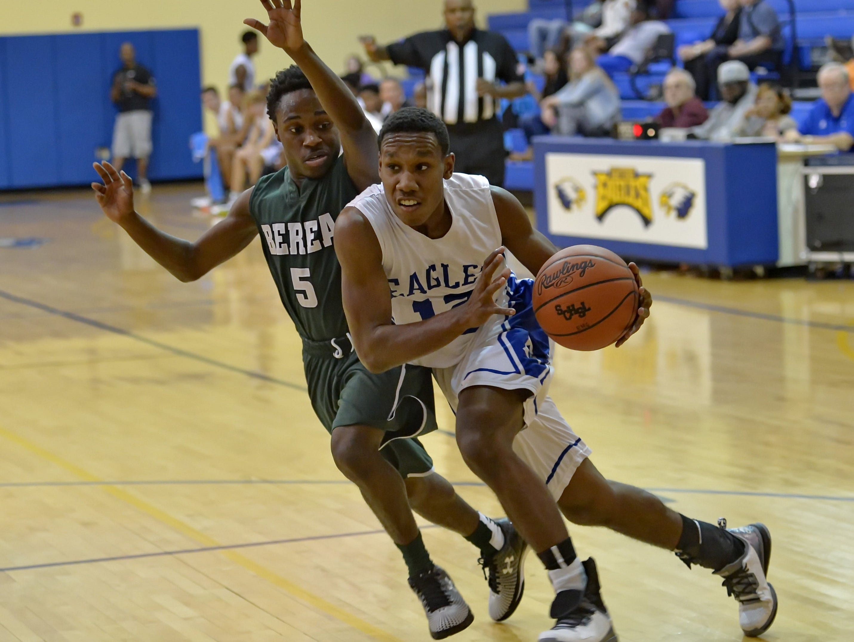 Eastside's Darius Foster drives down the lane while defended by Berea's Ta'mious Young during the Eagles' 65-62 win in the Greenville County Tip-Off Tournament championship game Wednesday at Eastside.