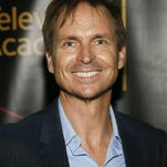 "Phil Keoghan from ""The Amazing Race"" poses at the Television Academy's 67th Emmy Documentary and Reality Nominee Reception at Mr. C Hotel on Friday, Sept. 11, 2015 in Los Angeles. (Photo by Danny Moloshok/Invision for The Television Academy/AP Images)"