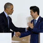 President Obama and Japanese Prime Minister Shinzo Abe shake hands after speaking to media in Shima, Japan on May 25, 2016.