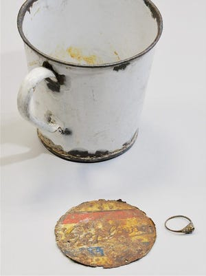 The ring and other valuables were found by the Auschwitz Museum inside this mug.
