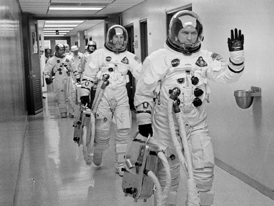 Commander Frank Borman leads the way for fellow astronauts,