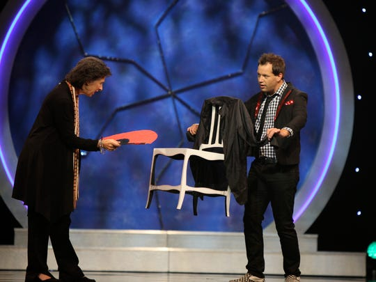 Magician Farrell Dillon performs his signature floating-chair trick.