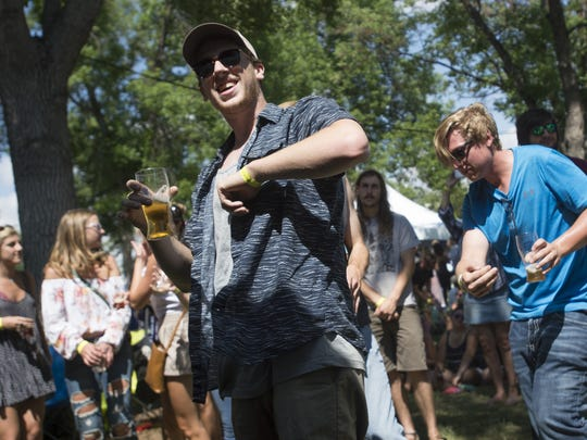 Branden Hillman dances along to Write Minded as they perform during the 2017 Colorado Brewers' Festival.