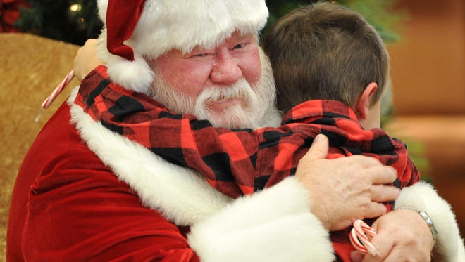 Santa Claus received a big hug Thursday after making an appearance at the lobby of First National Bank. Jan Waldmuller of First National Bank said parents and grandparents were encouraged to bring phones and cameras to capture memories of the event.