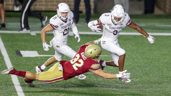 Texas State's Jeremiah Haydel is tackled by Boston College's Nick DeNucci on the final play of the game -- a Boston College kickoff, after the game-winning field goal with three seconds left. The Eagles won, 24-21.