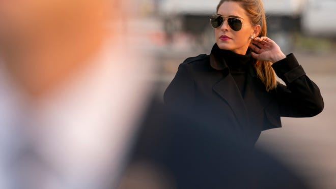FILE - In this Sept. 12, 2020, file photo, Counselor to the President Hope Hicks arrives with President Donald Trump at Reno-Tahoe International Airport in Reno, Nev. Hicks has tested positive for the coronavirus. Hicks, who serves as counselor to the president and traveled with him to a Wednesday, Sept. 30, 2020 rally, tested positive Oct. 1, according to an administration official who spoke on condition of anonymity to discuss private health information.
