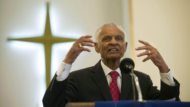Civil rights pioneer the Rev. C.T. Vivian preaches during a commemoration of the 50th anniversary of the Civil Rights Act in June 2014 in Knoxville, Tenn.