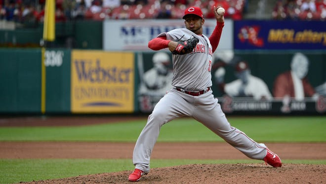 Reds left-hander Wandy Peralta earned his first win in Sunday's 5-4 Reds victory in St. Louis.