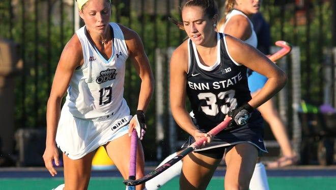 Penn State's Katie Dembrowski (33) moves the ball upfield against Old Dominion earlier this season. Penn State defeated ODU, 6-2.