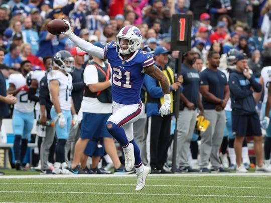 Bills Jordan Poyer celebrates a fumble recovery against the Titans.