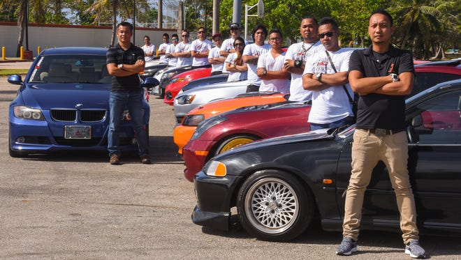 Lowered 2 Perfection President Philip Beltram, right, and other club members proudly stand besides their rides at the Paseo in Hagåtña on Tuesday, March 7, 2017.