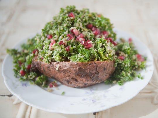 Stuffed sweet potato with kale, quinoa, and pomegranite