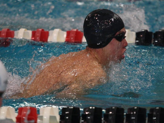 Milford'sTyler Babinec competes in the 100 breaststroke prelims at the Division I state meet on Feb. 24, 2017.
