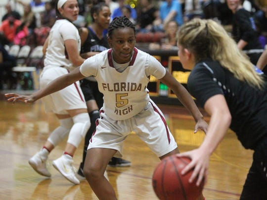 Tonie Morgan guards on full-court press defense during