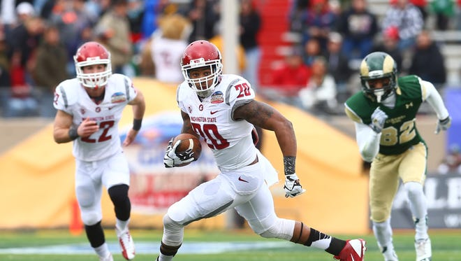 Washington State Cougars safety Deone Bucannon (20) returns an interception in the second quarter against the Colorado State Rams during the Gildan New Mexico Bowl at University Stadium.