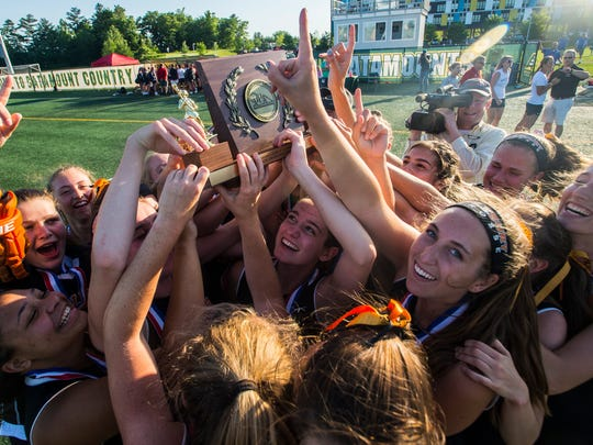 Middlebury celebrates after defeating CVU during the D1 girl's lacrosse championship at Virtue Field at UVM on Friday night, June 8, 2018.