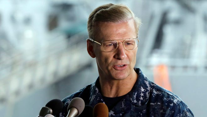 U.S. Navy Vice Adm. Joseph Aucoin, commander of the U.S. 7th Fleet, is pictured speaking during a news conference.