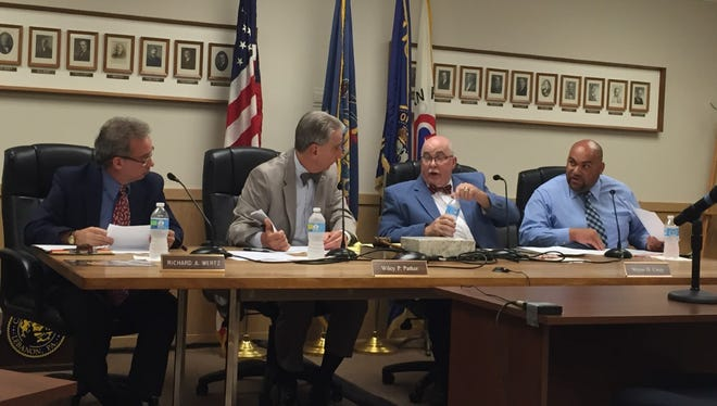 Lebanon City Council (from left) Richard Wertz, Chairman Wiley Parker, Wayne Carey and Cornell Wilson chat during Wednesday night's interview of nine candidates who have applied to fill a vacancy on the five-member board.