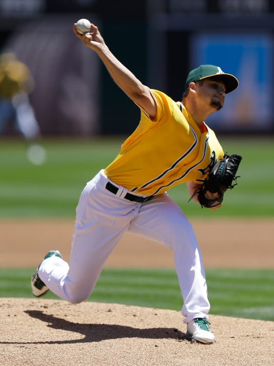 Oakland Athletics pitcher Kendall Graveman works against the San Diego Padres in the first inning of a baseball game Thursday, June 18, 2015, in Oakland, Calif. (AP Photo/Ben Margot)