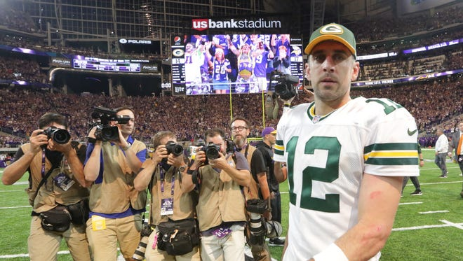 Packers quarterback Aaron Rodgers walks on the field after the game against the Vikings.