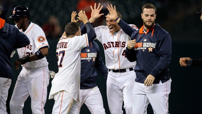 The Houston Astros, bolstered by young players like George Springer (center), are nearing a .500 record after three straight 100-loss seasons.