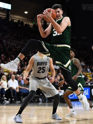 CSU's Nico Carvacho pulls down a rebound Wednesday night in the Rams' 72-58 win over Colorado in Boulder.