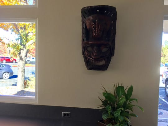 A Hawaiian tiki mask adds an island touch at the new