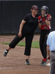 Pulaski coach Billi Jo Vertz gives Madi Winter a hug after the sophomore hit a triple during their WIAA Division 1 state quarterfinals game against Divine Savior Holy Angles at Goodman Diamond in Madison, Wis., June 9, 2016.