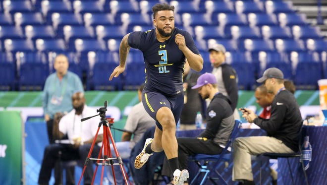 Tennessee defensive end Derek Barnett runs the 40-yard dash at the 2017 NFL football scouting combine Sunday, March 5, 2017, in Indianapolis.