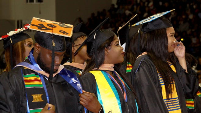 Summa Cum Laude Shirneal Handfield is overcome with emotion during a past Savannah State University graduation.