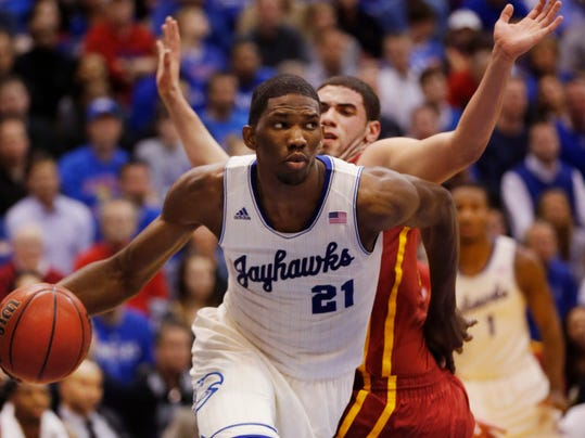 FILE - In this Jan. 29, 2014 file photo, Kansas center Joel Embiid (21) works around Iowa State forward Georges Niang, back, during the first half of an NCAA college basketball game in Lawrence, Kan. Embiid is a possible pick in the 2014 NBA Draft, Thursday, June 26, 2014 in New York.(AP Photo/Orlin Wagner, File)