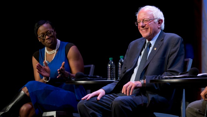 Sen. Bernie Sanders, I-Vt., right, smiles as former Ohio state senator Nina Turner, left, claps during a campaign event in New York in April.