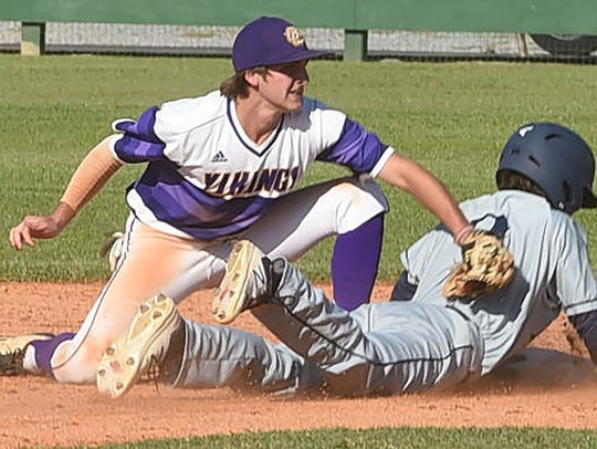 An Episcopal player is tagged at base in the Quarterfinal