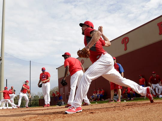 Philadelphia Phillies relief pitcher Phillippe Aumont, right, throws during a spring training baseball workout, Tuesday, Feb. 17, 2015, in Clearwater, Fla. Phillies pitchers and catchers begin official workouts Feb. 19. (AP Photo/Lynne Sladky)