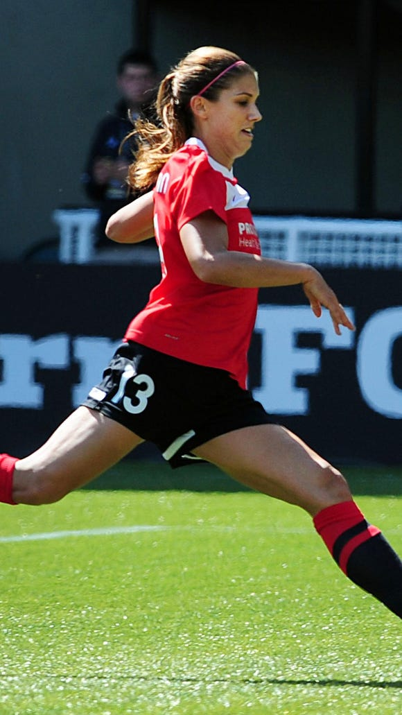 Former WNY Flash forward Alex Morgan, shown here playing for the NWSL's Portland Thorns in 2013, is back in Sports Illustrated's swimsuit issue.